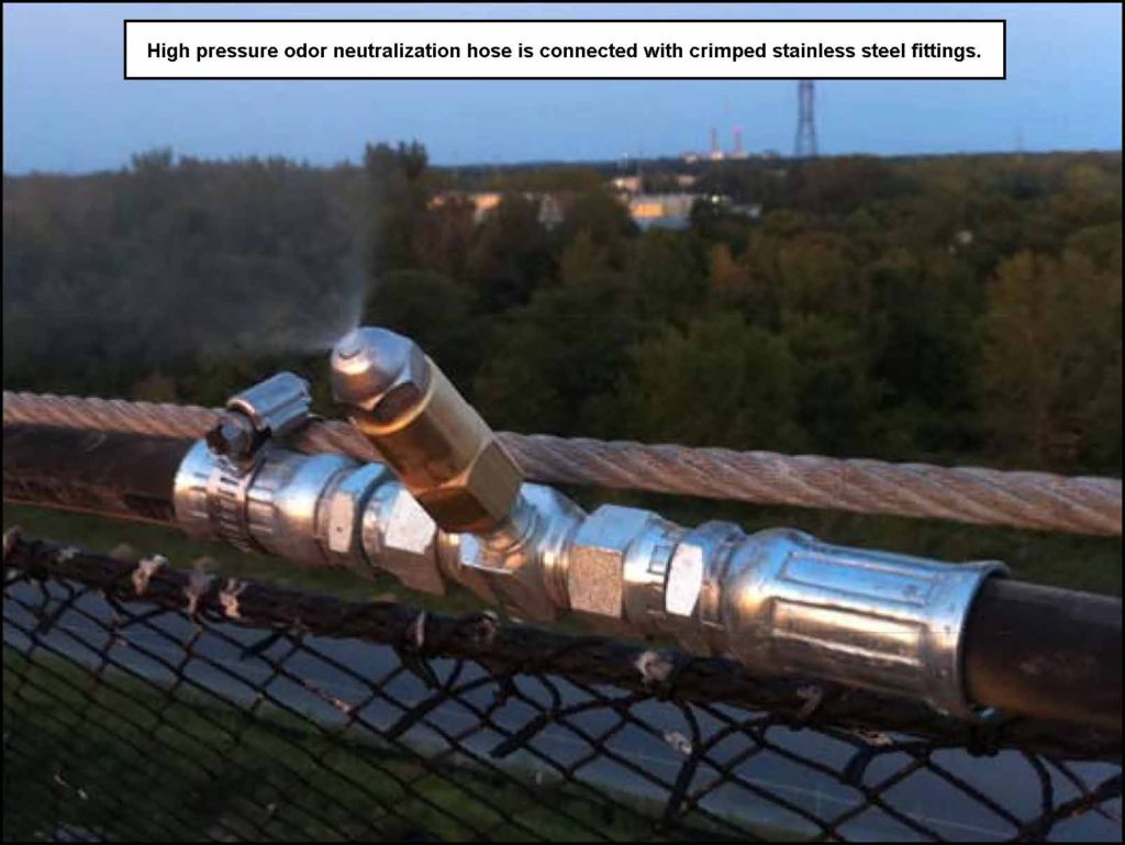 Odor_Control_Aerosol_Neutralization_Nozzle_on_Litter_Fence_Close-Up